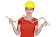 craftswoman holding a meter ruler