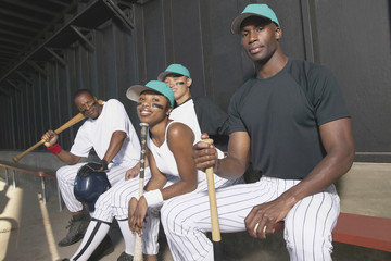 Portrait of baseball team in dugout