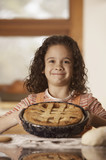 Portrait of girl with homemade pie