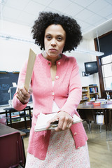 Portrait of angry teacher with ruler