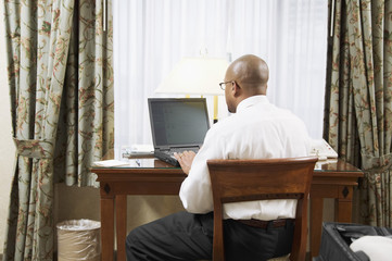 Businessman with laptop at desk
