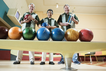 Group portrait of men with bowling balls