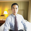 Portrait of businessman sitting in hotel room