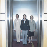 Portrait of three businesswomen in elevator