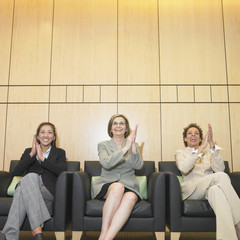 Three businesswomen clapping