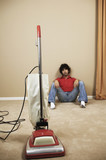 Young man resting during vacuuming