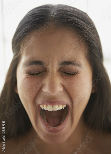 Close up of young woman screaming