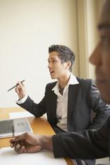 Businessmen sitting in meeting