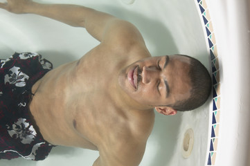 Young man relaxing in a jacuzzi
