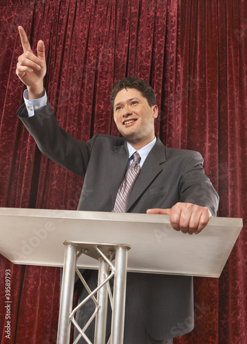 Businessman making a speech onstage