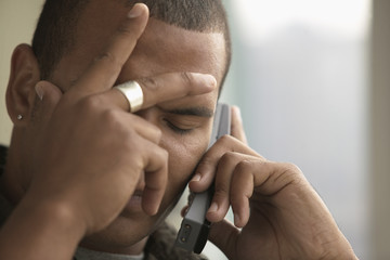 Close up of man talking on cell phone