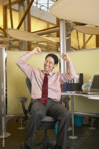 Businessman celebrating at desk