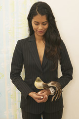 Businesswoman holding a stuffed bird