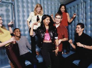 Friends dancing in padded room