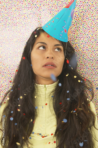 Annoyed woman wearing a party hat