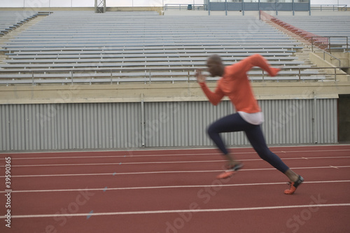 Male athlete running on track