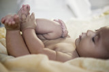 Close up of baby playing with toes