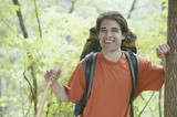 Young man backpacking in forest