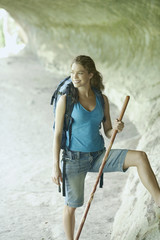 Young woman hiking in a canyon