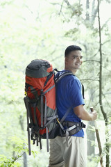 Young man backpacking in a forest