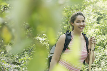 Young woman hiking in a forest