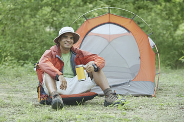 Young man at his campsite