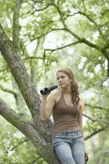 Female hiker using binoculars