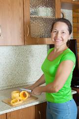 woman slicing vegetable marrow