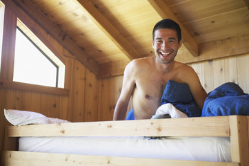 Man sitting in wooden bunk