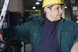 Man in warehouse holding steering wheel