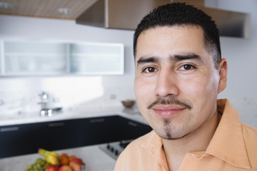 Headshot of man in kitchen