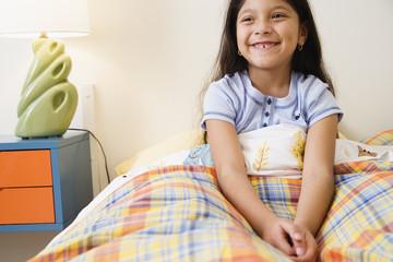 Girl sitting in bed