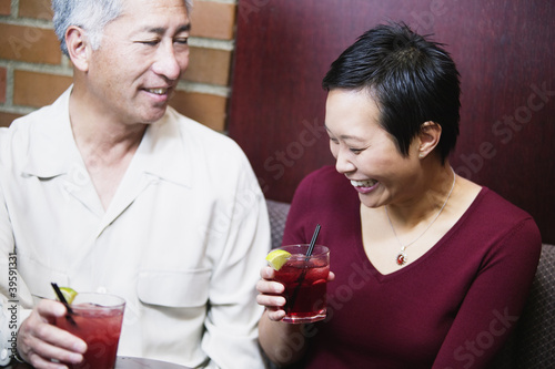 Couple having drinks together