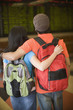 Young couple wearing backpacks