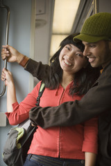 Young couple on subway train