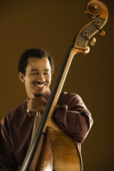 Man posing with his double bass instrument