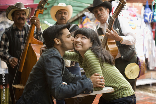 Young couple with Mariachi band