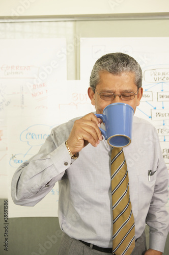 Businessman drinking from coffee cup