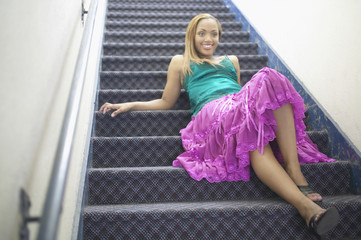 Young woman reclining on staircase