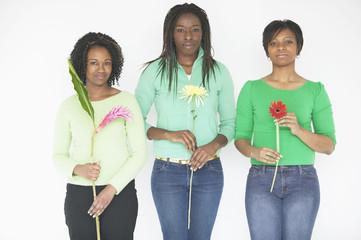 Three women holding flowers