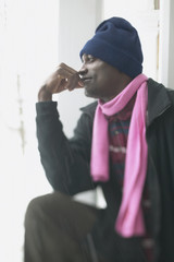 Profile of a man wearing a scarf