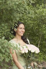 Young woman holding a flower arrangement