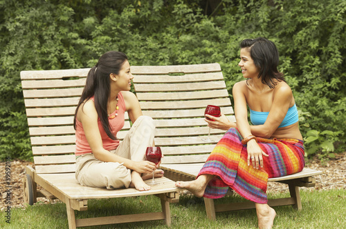 Two young women sitting outdoors
