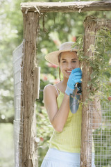 Young woman wearing gardening gloves