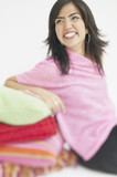 Hispanic woman leaning on pillows smiling