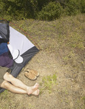 Man sleeping inside tent