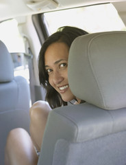 Woman smiling from SUV passenger seat