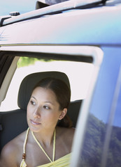 Woman looking out passenger window