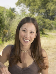 Attractive woman smiling in natural setting