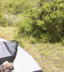 Man sleeping inside tent